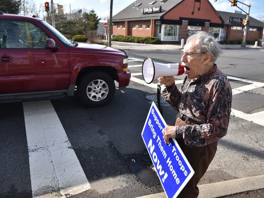 A 99-year-old peace activist, Henry Shoiket, shouts