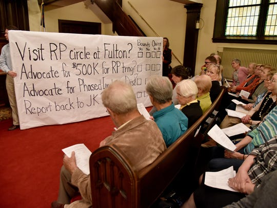 Volunteers hold a board with questions and commitments Justice Knox is seeking from the Knox County School System at a forum with city, county and school officials at Central United Methodist Church on Monday April 24, 2017.  (J. Miles Cary/Special to the News Sentinel)