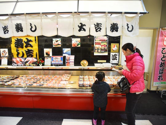 This is a food crawl.  Photo of the sushi section at