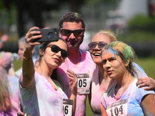 New Milford High School student Nicolle Velasquez, right, in a selfie with her sister Michelle, left, Michelle's boyfriend, Doug Reudter, and her mother, Sandra, at the end of Sunday's benefit run.