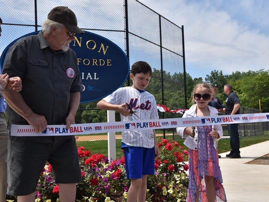 Late Shannon Dalton Forde' father Michael Dalton and her children Nicholas and Kendall cut the ribbon at the naming of a Little League field, which was built by Major League Baseball and be named Shannon Dalton Forde Field. Shannon, a native of Little Ferry, worked for the New York Mets for 22 years and passed away from breast cancer in 2016.