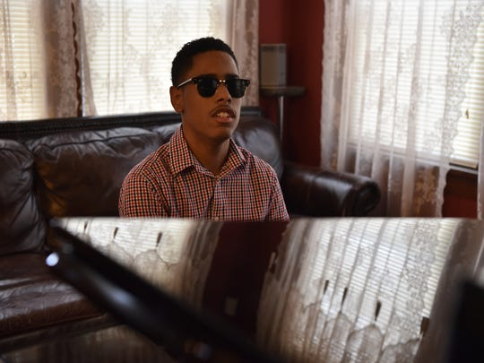 20027459A Matthew Whitaker, a 15-year old piano prodigy of Hackensack, plays music in his home.