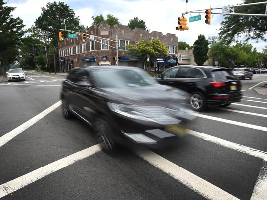Cars move across the intersection of Fort Lee Road
