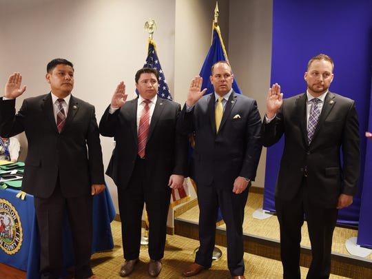 (L to R) Michael Guzman, Brian Lucas, Jason Hornstra and James Eckert are promoted as Sergeants of Detectives by Prosecutor Gurbir S. Grewal (not shown) during the Bergen County Prosecutors' Swearing-in Ceremony at Two Bergen County Plaza Conference Center in Hackensack on July 17th, 2017.