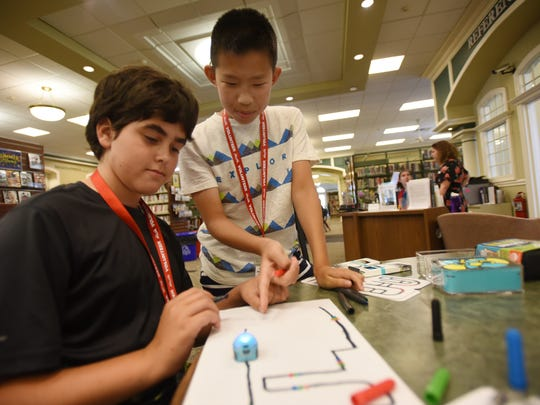Volunteers Tal Ledeniov (age 12, L) and Maxwell Yuan (age 12, R) play with Ozobot during a drop-in program that allows children to experiment with various technology and create things, photographed at Glen Rock Public Library on July 18th, 2017.