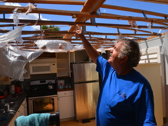Kevin Luttrell of Merritt Island who has a riverfront trailer at the River Palms Mobile Home park, explains what happened to his roof during Hurricane Irma.