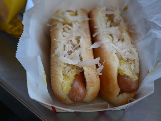 Two hotdogs with sauerkraut and mustard at Rosie's Weenie Wagon in Englewood.