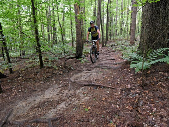 Sean Scott of Michigan enjoys a mountain bike ride around Mohican State Forest on Thursday.