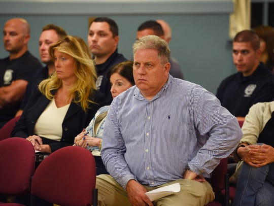 Saddle River residents listen during the meeting at