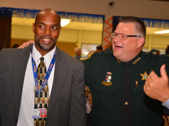 Dr. Desmond Blackburn, superintendent of Brevard County Schools, and Brevard County Sheriff Wayne Ivey swap playful banter during the United Way of Brevard's 2017 campaign kick off luncheon Wednesday at the Melbourne Auditorium.