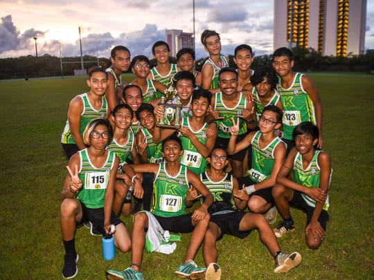 The John F. Kennedy Islanders' boys cross country team captures third place for the season during the Independent Interscholastic Athletic Association Cross Country League All-Island cross country meet at John. F. Kennedy High School on Thursday, Oct. 5, 2017.