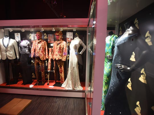 Photo of showcases of singers costumes including a dress of Taylor Swift (R) are seen at Grammy Museum Experience at Newark's Prudential Center in Newark, photographed on 10/16/17.