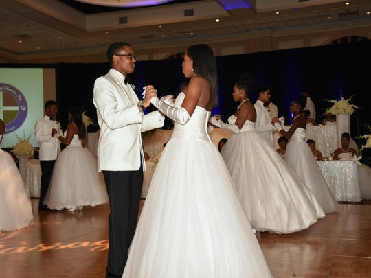Presentees perform a waltz during the 2017 Jack and Jill Black and White Gala Nov. 18 at the Chase Center on the Riverfront.