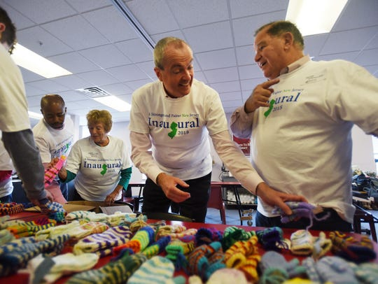 Governor-elect Phil Murphy sorts out hand made knitted