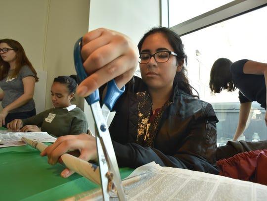 Sabrina Valderrama, of STEM Girls, makes materials