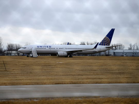 A United Airlines airplane sits about 250 feet off the end of a runway at Green Bay-Austin Straubel International Airport Friday. The plane, with 187 passengers and crew, slid off the runway early Friday morning. No one was injured.
