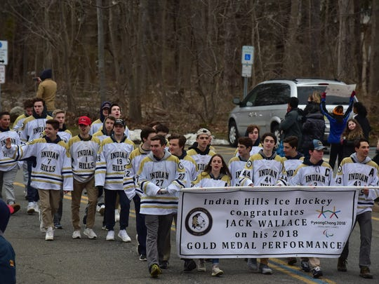 Indian Hills Hockey team participates in  a parade