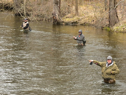 Anglers fish for trout on an opening day of trout season in Mahwah.