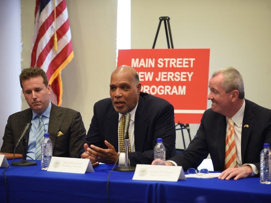 Montclair Mayor Robert Jackson speaks about Main Street NJ and neighborhood preservation as Essex County Freeholder Brendan Gill, Gov. Phil Murphy and other officials listen during the roundtable discussion at Montclair Fire Headquarters in Montclair on 4/12/18.