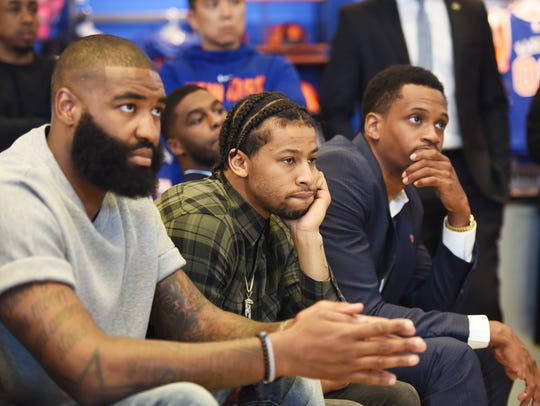 Knicks' players (L to R), Kyle O'Quinn, Trey Burke