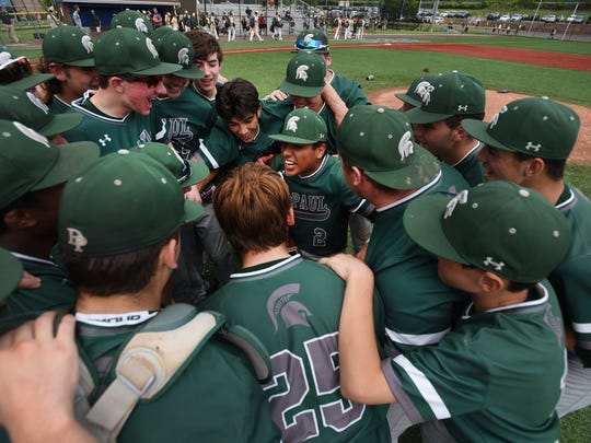 DePaul players celebrate their 5-1 victory over Passaic Valley on the mound after their Passaic County baseball tournament championship at Passaic Tech's field in Wayne on May 20, 2018.