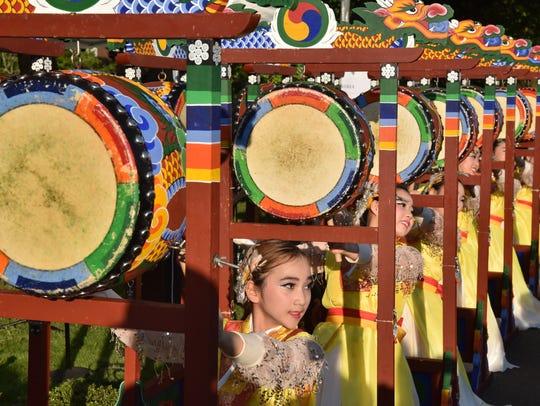 Woorigarak Korean Cultural Arts Center performers play