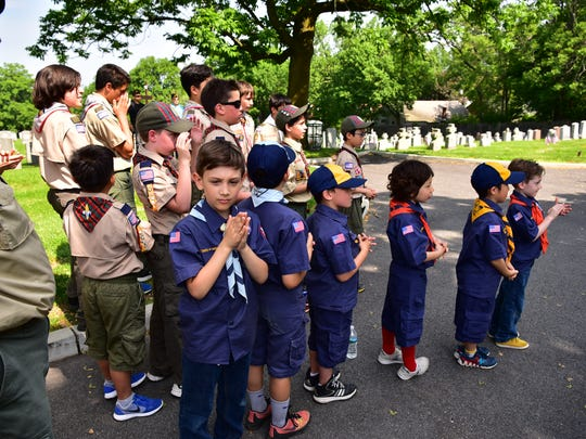 Boys scouts participate in the ceremony of decorating graves of the fallen soldiers at Madonna Cemetery in Fort Lee, NJ.