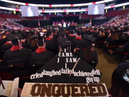 Sentiments on graduation caps at a Ramapo College commencement ceremony.