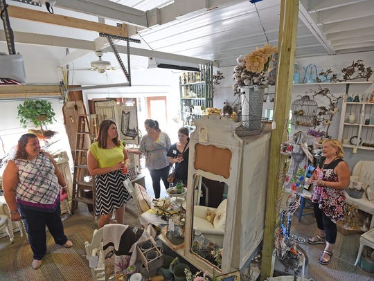 Beth Nunn shows the newest part of her store, A Heritage