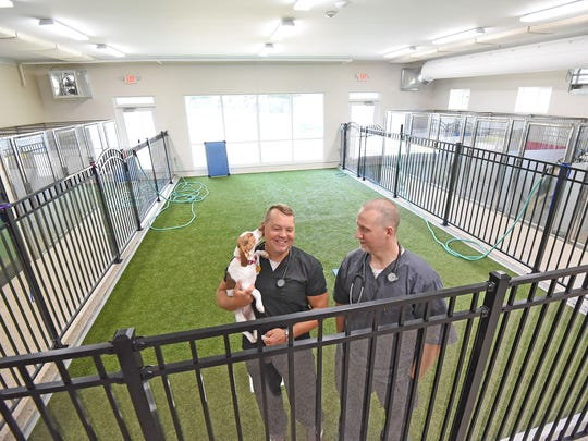 Abel and Jobe Hittinger are excited about their new facility at Appleseed Veterinary Clinic including a large boarding area with indoor play area and televisions in the dog pens.