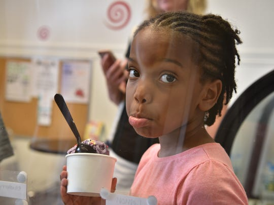 Ice cream expert Ariana at Marc's Cheesecake trying out three different flavors