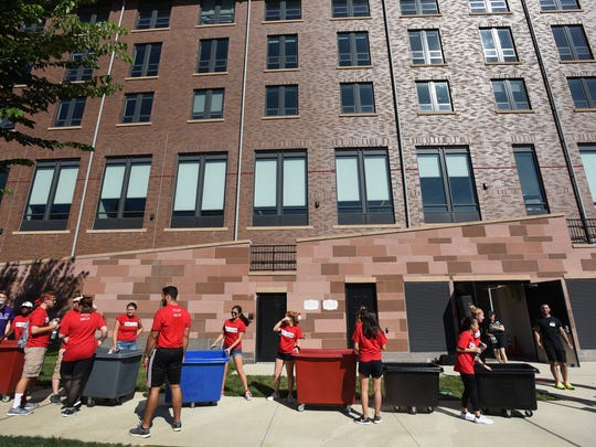 Volunteer students wait in line with their carts as they are ready to help incoming students during the Rutgers Moving In Day at the Rutgers Honors College dormitory in New Brunswick on 08/30/18.