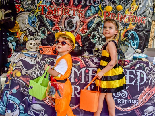 These kids take a moment to strike a pose at Pumpkin Fest, where more than 35 vendors provided candy and fun activities for kids and parents alike, along Vendor Row.