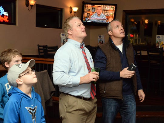 Sideline Bar & Grill in Millville is a spot where many South Jersey fans will check out the Super Bowl on Feb. 2. In this Courier Post file photo, Derek Kavanagh (center), his sons Matthew Kavanagh (left), and Aidan Kavanagh, and his brother Brendan Kavanagh, all of Millville, watch as Mike Trout is named AL MVP on TV at the bar and grill in 2014.
