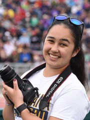 Augusta student, Ariana Birondo, takes photos during Howard Wood Dakota Relays in Sioux Falls, S.D., Saturday, May 7, 2016.