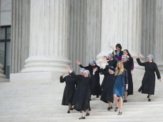 Nuns from the Little Sisters of the Poor and fellow plaintiffs leave the Supreme Court in March following oral arguments on religious non-profits' effort to eliminate contraceptives from their health insurance policies on religious grounds.