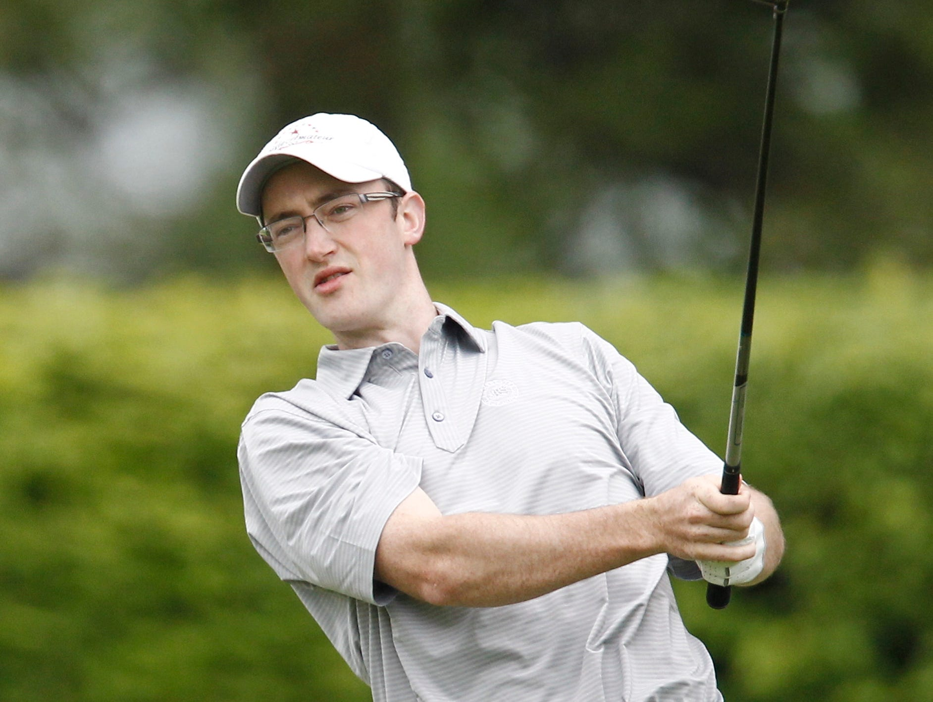 Luke Feehan hits his tee shot on the first hole during day 2 of the 2016 U. S. Amateur Four-Ball Championship at Winged Foot Golf Club in Mamaroneck on Sunday, May 22, 2016.
