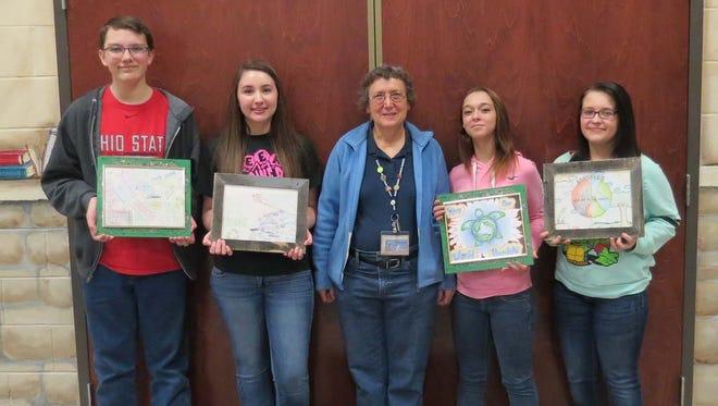 From left, Brady Rosenberger, Emily Crowe, and Lakota art teacher Deb Obe.