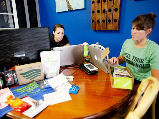 Laura Jorgensen, left, co-owner of Runner Box, and Courteney Lowe, head of social media, regularly work from Little Sparrow Coffee and Kitchen in Woodfin.