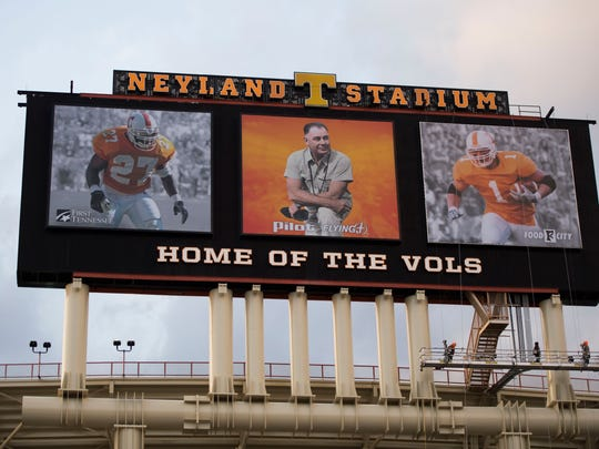 A crew finishes putting up a photo of Jason Witten on the video board at Neyland Stadium Tuesday, March 13, 2018.