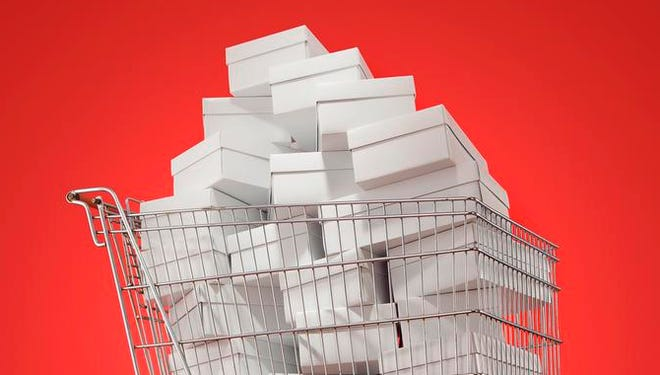 Photoillustration of shopping cart filled with white boxes for USA WEEKEND cover story on impulse shopping. Credit: John Kuczala for USA WEEKEND