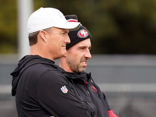 San Francisco 49ers head coach Kyle Shanahan, right, watches as players practice with general manager John Lynch at the team's NFL football practice facility in Santa Clara, Calif., Wednesday, Jan. 15, 2020. The 49ers will host the Green Bay Packers for the NFC Championship on Sunday. (AP Photo/Tony Avelar)
