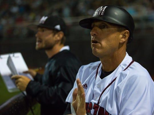 NMSU head baseball coach Brian Green talks to his players
