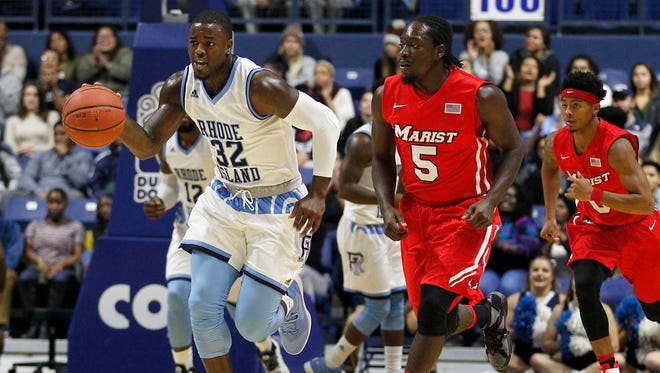 Rhode Island's Jared Terrell (32) dribbles the ball up court after stealing it from Marist's Khallid Hart (5) during the first half of an NCAA college basketball game, Monday, Nov. 14, 2016, in South Kingstown, R.I.
