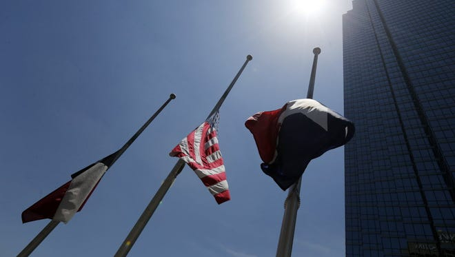 Flags at half staff in Dallas near the site of a shooting that killed five Dallas police officers, July 8, 2016.