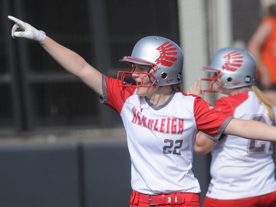 Hermleigh's Kami Smith celebrates after scoring on Brishaya Sneed's two-run single in the fifth inning to cap a six-run inning and break open a 4-4 game. Hermleigh beat Rotan 17-8 in the one-game Region I-1A semifinal playoff Saturday at ACU's Wells Field.