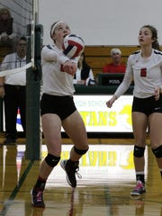 Lourdes Academy's Sophie Jensen bumps up the ball during