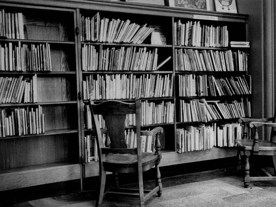 """There doesn't appear to be anything remarkable about this wall of books once in the downtown Rundel Library, but it concealed the entrance to a """"Secret Room."""""""