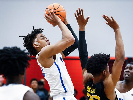 Georgia Stars guard Trendon Watford (left) puts up a shot against the Athletes Of Tomorrow during their Nike EYBL game in Dallas, Texas.