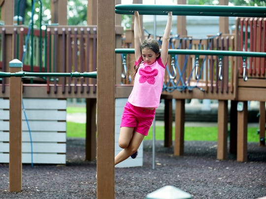 Hannah Hallisey of New London, CT, plays at the Rec Park playground in Binghamton on June 28, 2018.
